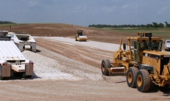 Installing gravel base on future drilling site